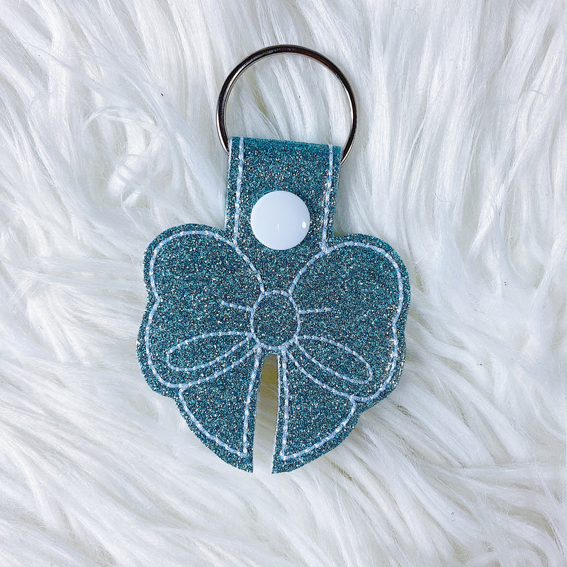 Turquoise Glitter with White Stitching Bow Feltie Snap-Tab Charm
