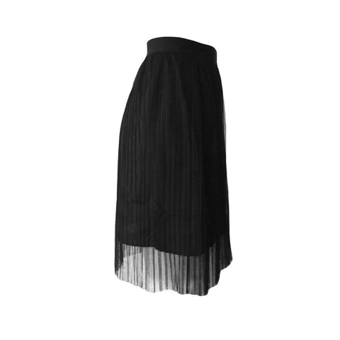 This black pleated skirt by Danish designed Grunt features delicate pleats and a simple waistband at the waist.  Midid length and lightweight, its the perfect teen skirt.