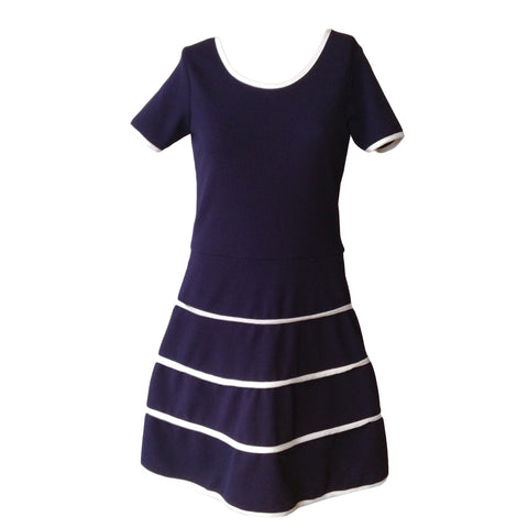 We love this Parisian Sailor dress by New York label Cheryl Creations.The navy and white piping combo makes it elegant and with good stretch it's super comfy.