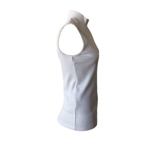 We love this White Turtleneck Tank by Danish designers Grunt.  It's the Perfect summer basic turtle neck tank that will match with all your high waisted denim.