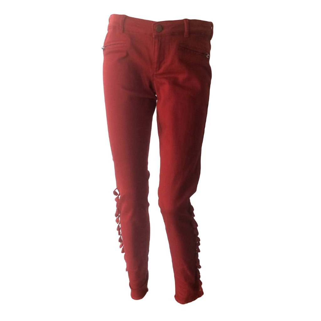 Moto jeans in rusty red with fringe detail by Scotch & Soda. We