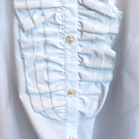 This is a beautiful white shirt by Scotch & Soda. Featuring front ruffle detail and pastel stitching. Made from a gorgeous crisp cotton with a romantic cut.