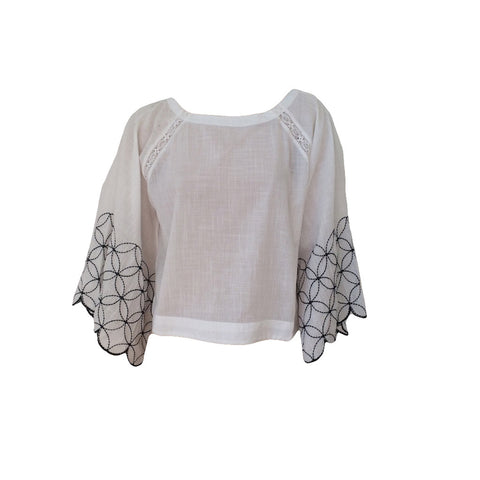 Cleverly constructed, this pretty isabella embroidered blouse with its flattering batwing sleeve has a beautiful embroidery and lace design. We love this styled with jeans, skirt or palazzo pants.