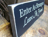Enter As Strangers Leave As Friends, Front Door Sign
