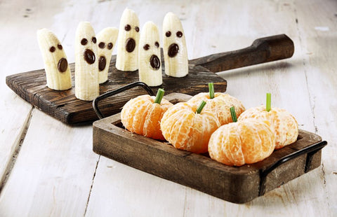 ghosts made of bananas and tangerines made to look like pumpkins