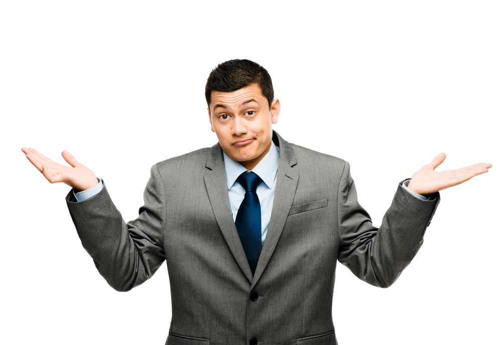 businessman holding arms up