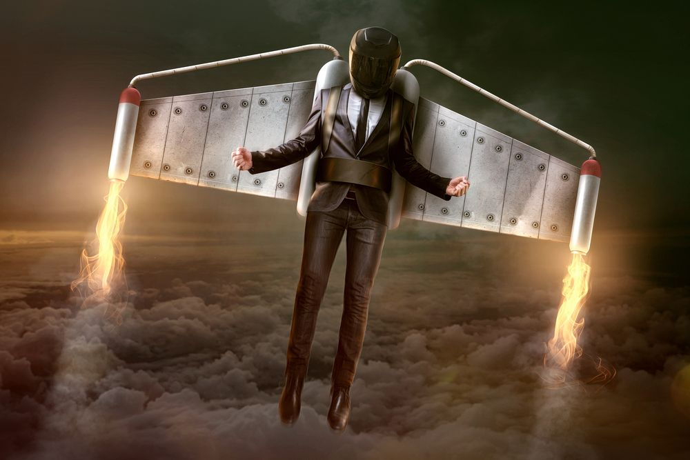 businessman flying with jetpack on fire