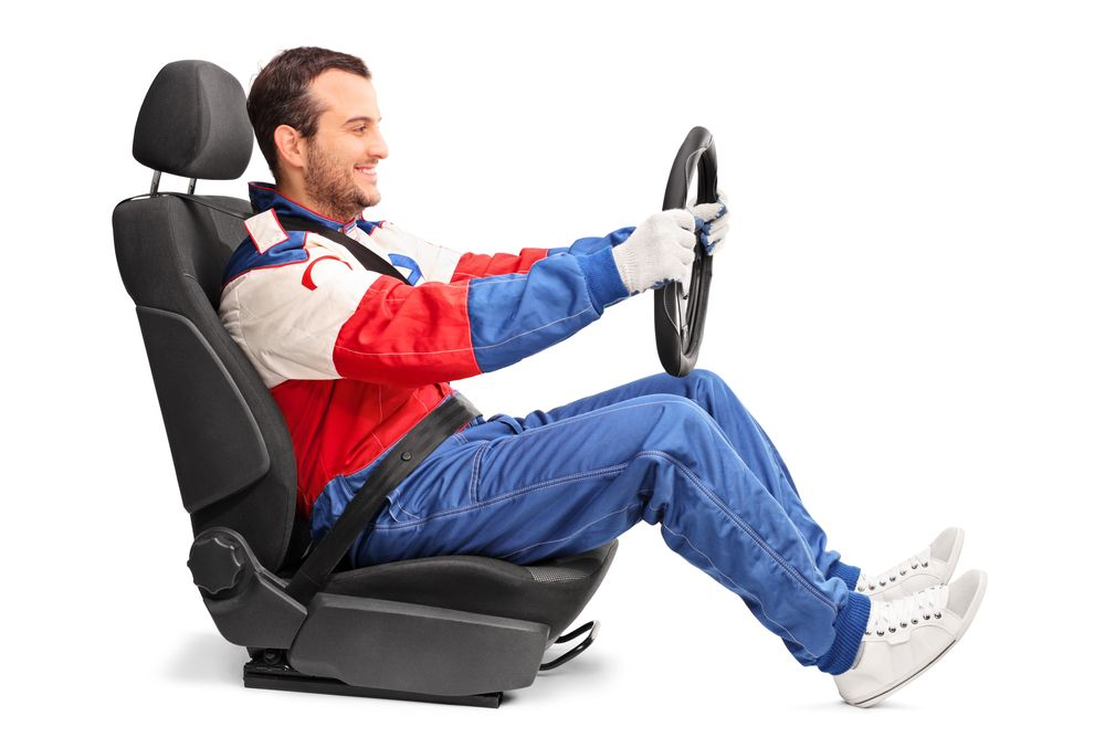 driver in a seat holding steering wheel