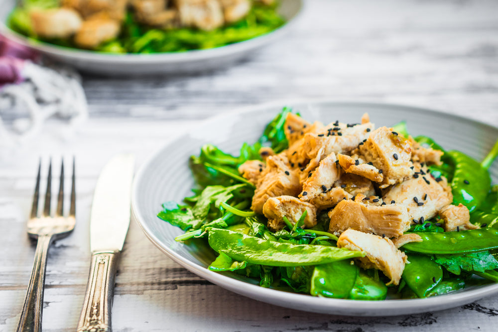 chicken and snow peas on a plate