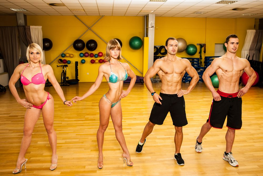 fitness competitors posing in gym