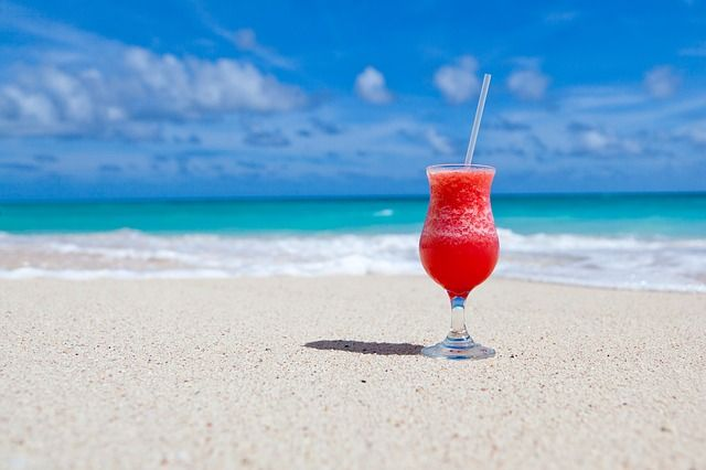 fruit drink on sandy beach