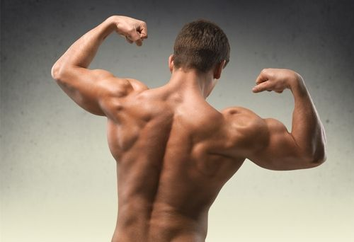 man flexing muscles of back