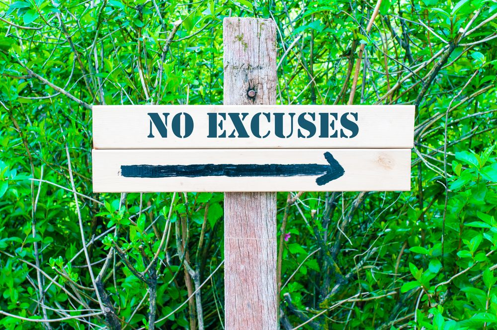 no excuses sign with trees in background