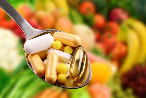supplements on a fruit background