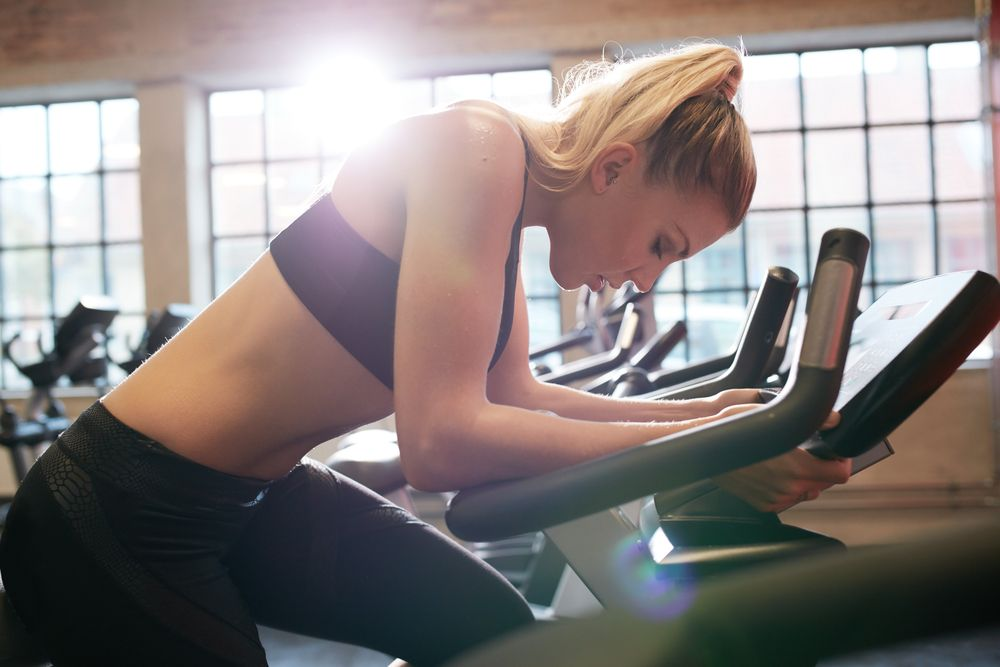 woman tired on exercise bike