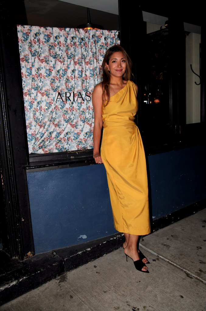 Founder and Creative Director Nina Sarin Arias in a One-Shoulder Draped Dress