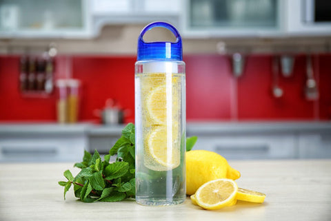 Plastic infuser water bottle with lemon water