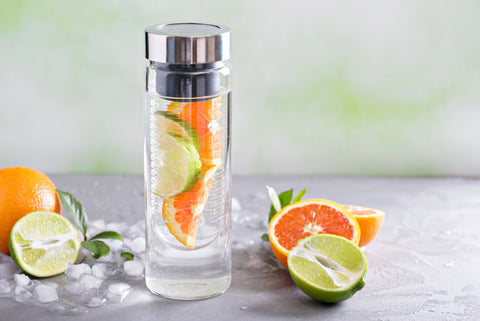 Plastic infuser water bottle with orange and lime water