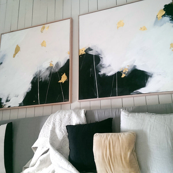 Monochrome paintings over the bed