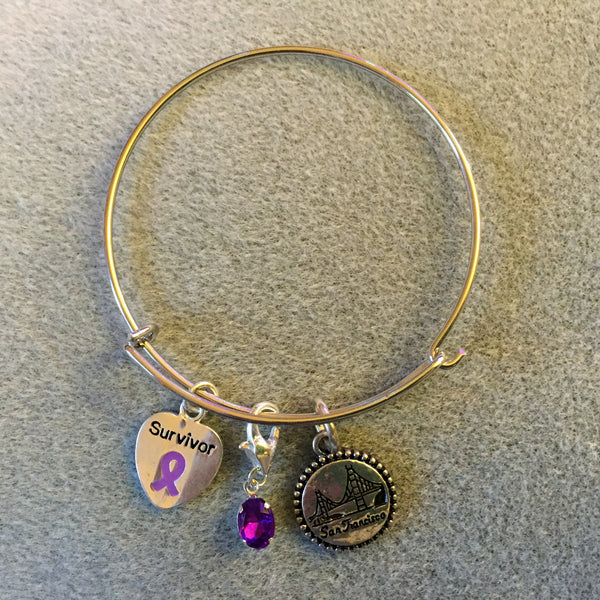 Bracelet with San Francisco and Purple Ribbon Charms