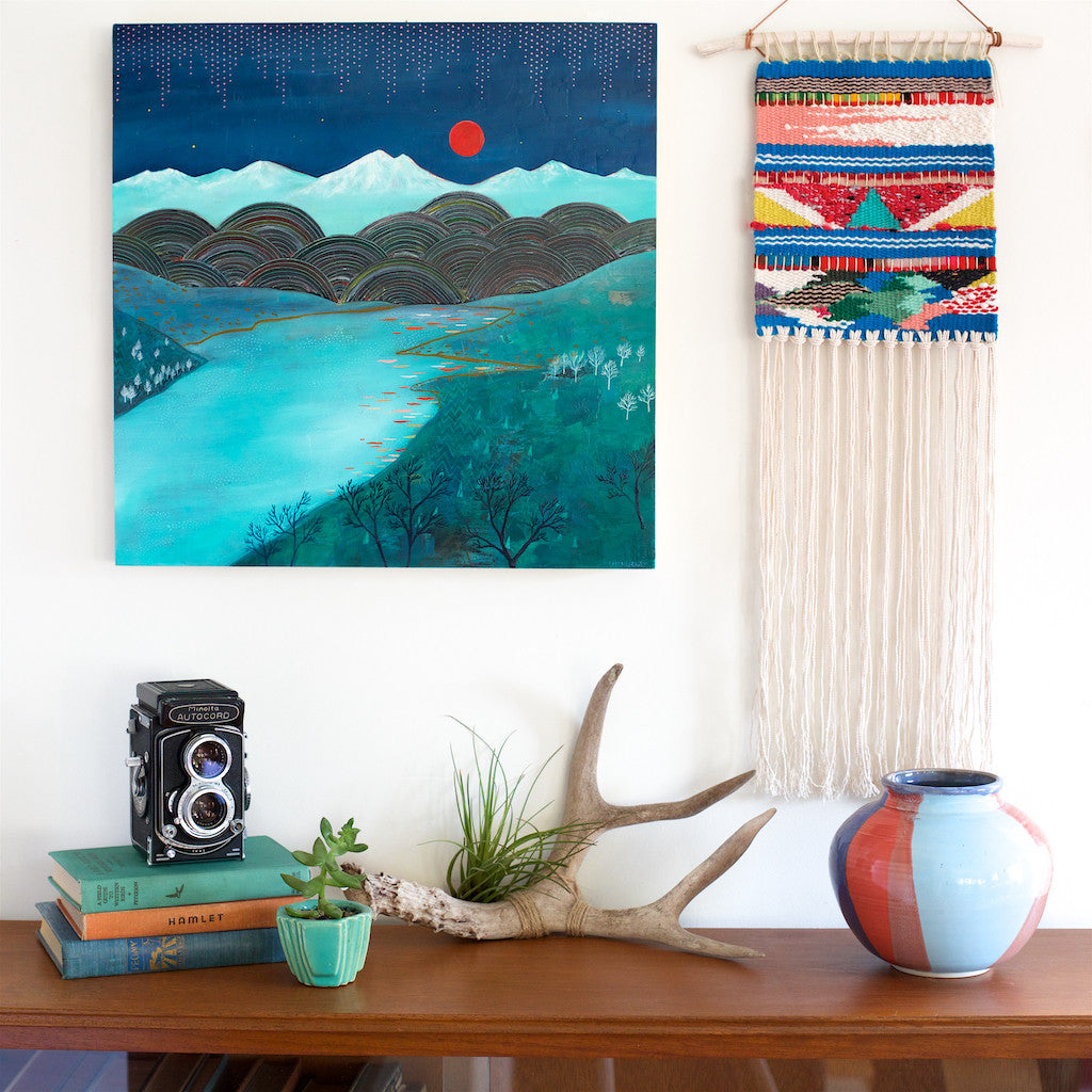 handwoven wall hanging with painting