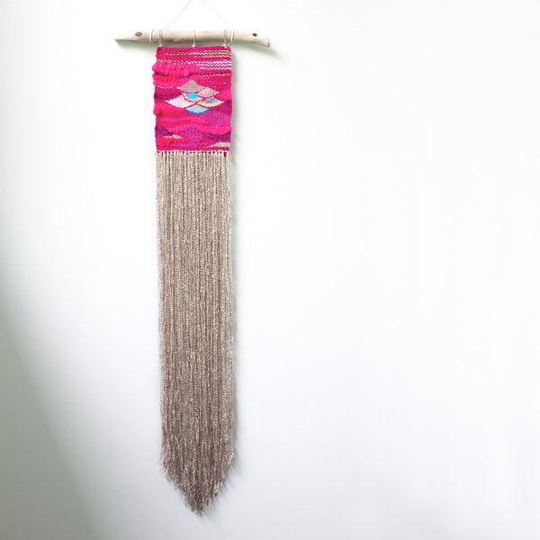 neon pink handwoven wall hanging