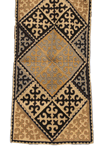 Dark Brown and Tan Rug with White, Beige, and Grey Filigree Pattern