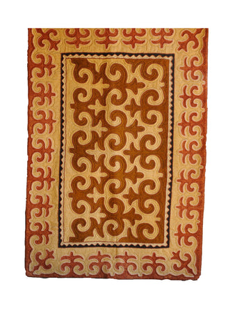 Red Felt Rug with tan Shapes and Deep Brown Shapes with Black and White Border