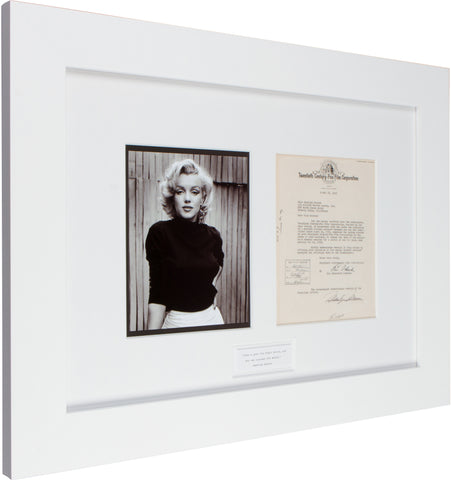 "Signed Marilyn Monroe: ""Give a girl the right shoes and she can conquer the world."""