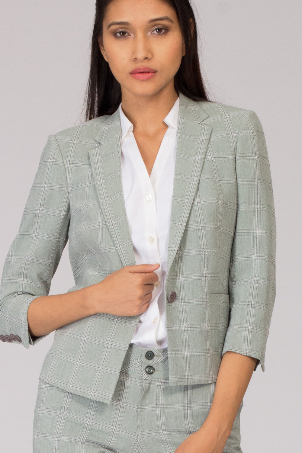 Light Green Check Semi Formal Blazer for Working Women. Shop for stylish business suits and professional looks at www.intermod.in