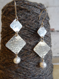 Pearl and silver earrings
