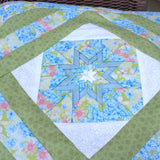 Qillow/Pillow/Lap Quilt/Lap throw - Forget-me-not Folded Star