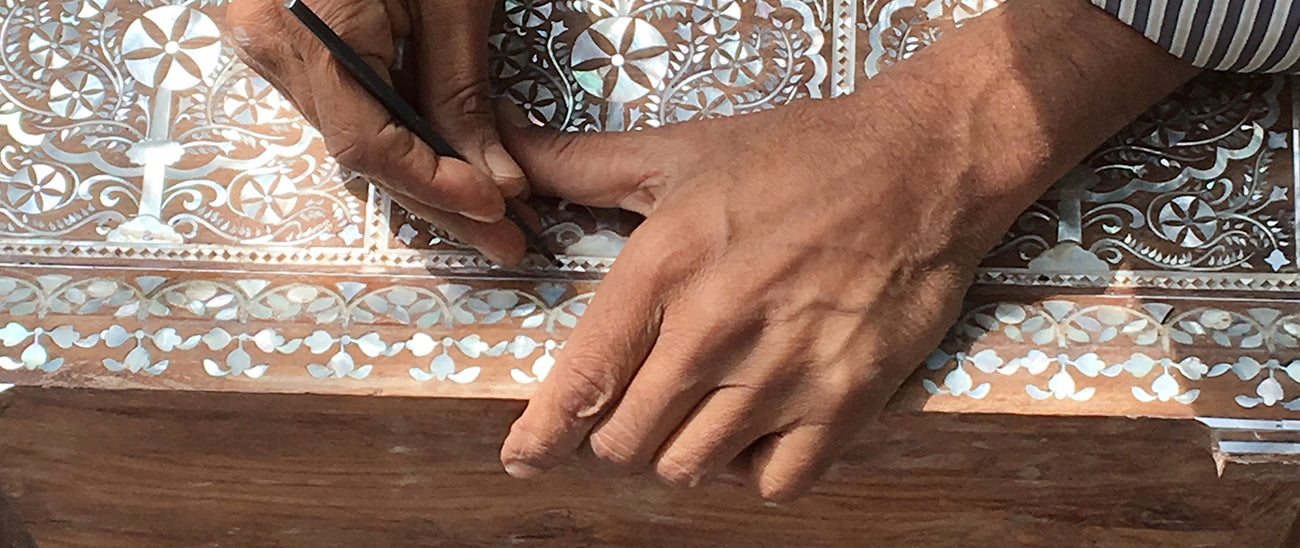 The art of Inlay is an ancient decorative technique that involves inserting pieces of materials such as wood, metal, ivory or even shells onto a base surface creating intricate designs.