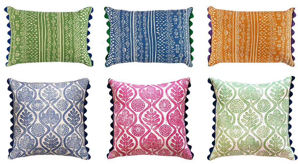 Wicklewood's Kirby and Oakleaves cushions in blue oblong, green oblong and orange oblong with rich rac scallop trim and blue, pink and green botanical print