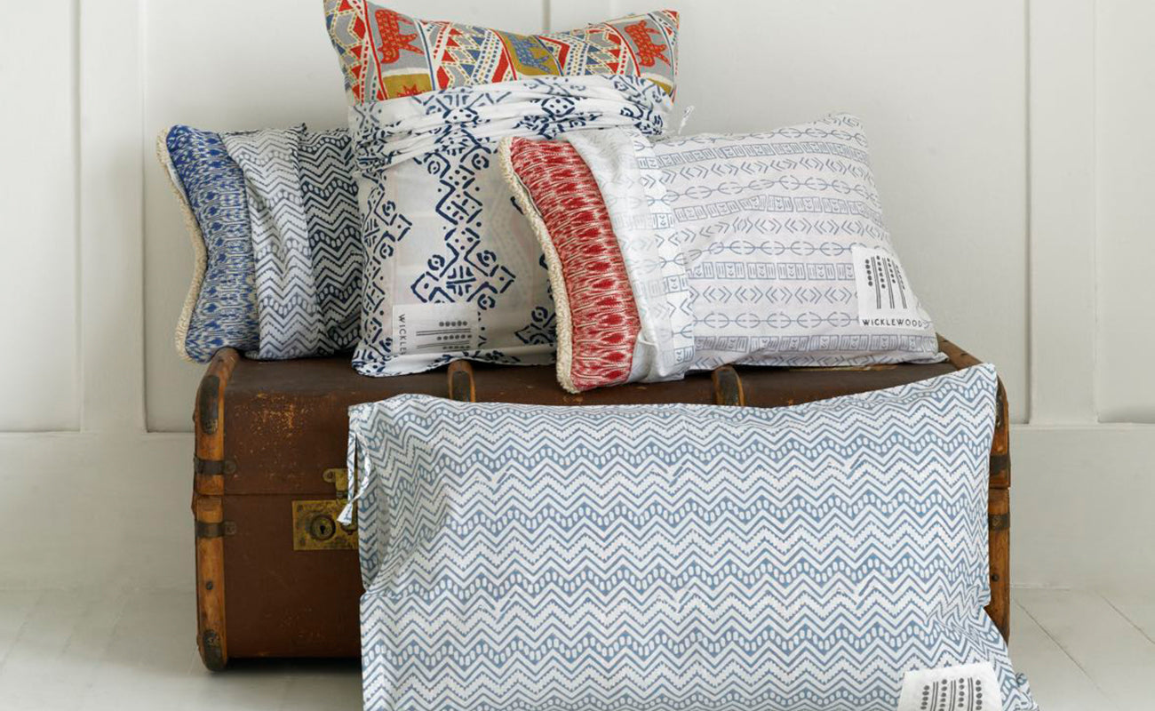 Wicklewood cushions come in a luxurious block printed dust bag, perfect to store clothes and to organise your suitcase
