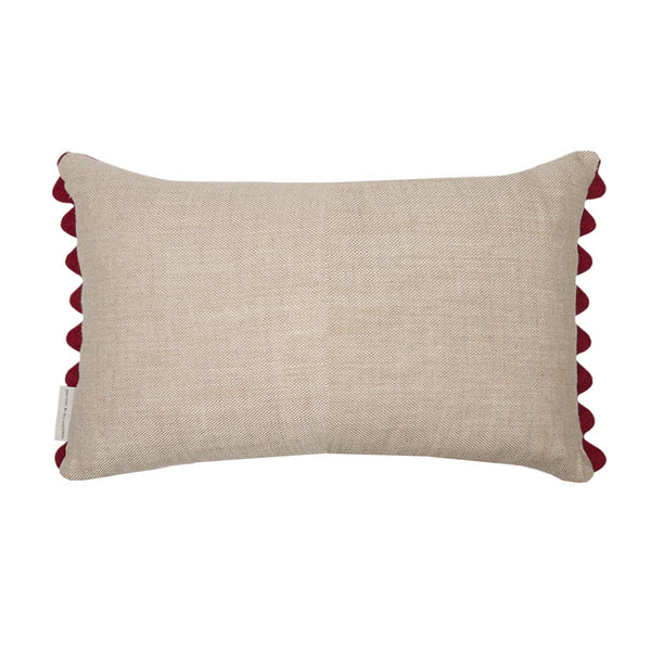 Guatemalan oblong cushion in pink and red striped jaspe ikat with burgundy ric rac trim and plain beige linen on the back