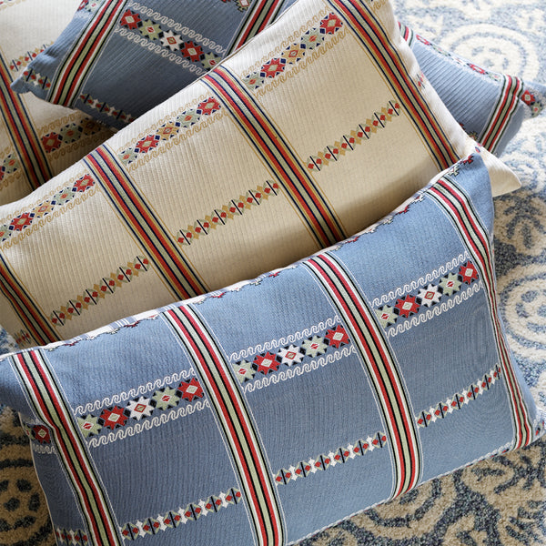 Wicklewood Lilly cream, red and gold oversized oblong artisanal woven cushion with Guatemalan motifs and classic stripes.