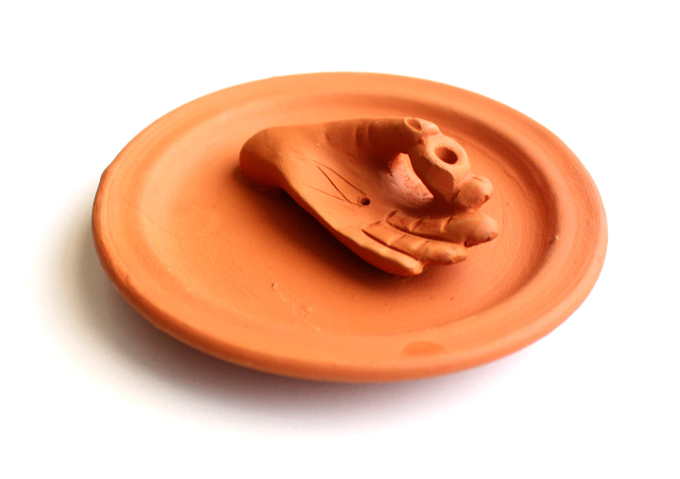Hand on a Ceramic Base Plate Incense Holder - nepacrafts