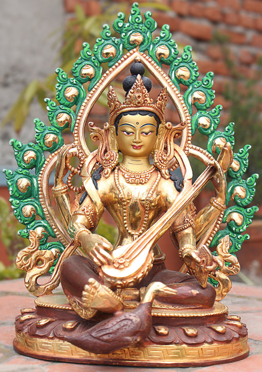 Four Armed Goddess Saraswati Partly Gold Plated Statue with Frame - nepacrafts