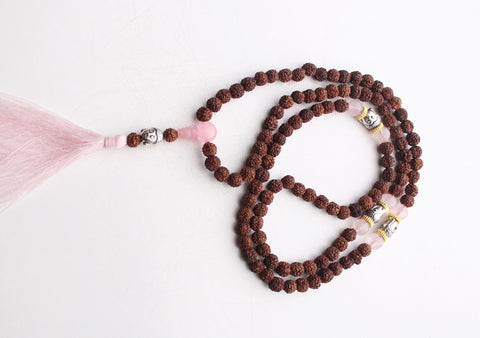 108 Rudraksha Prayer Beads Mala with White Metal Buddha Face Spacer - NepaCrafts