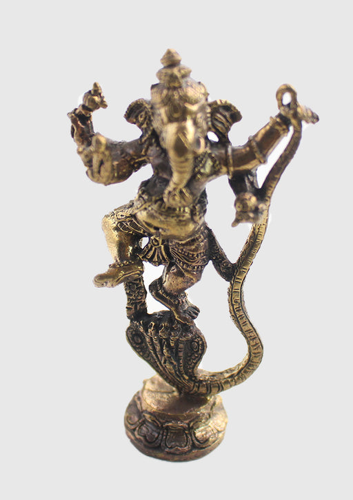 Dancing Ganesha on Snake Head Brass Statue - nepacrafts