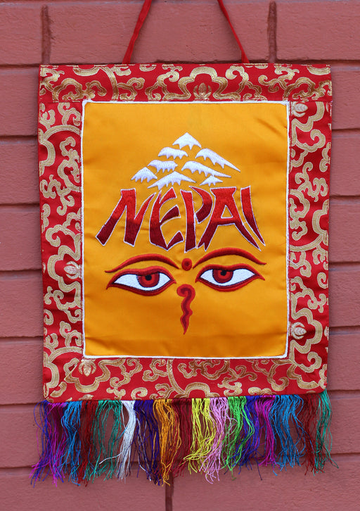 Brocade Framed Buddha Eyes and NEPAL Embroidery Wall Hanging