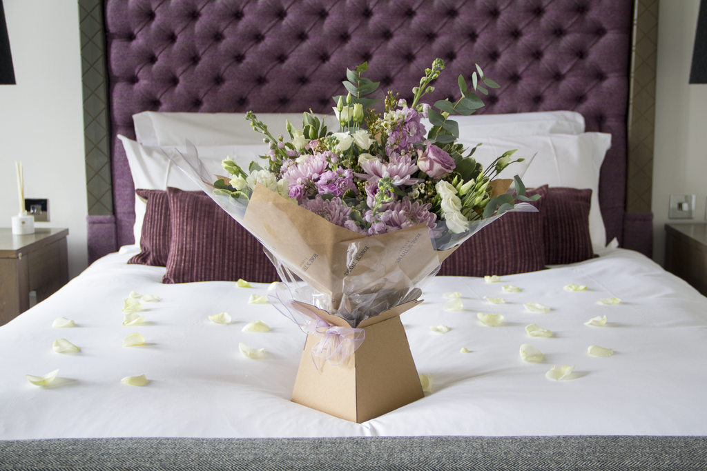 Beautiful bouquet of Rose n Thyme Flowers on a bed in the Blythswood Hotel Glasgow