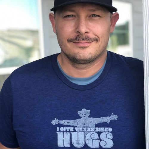 Texas Sized Hugs T shirt from Gusto Graphic Tees, big hugs, texas sized, cowboy t shirt, cowboy tee, cowboy hug, austin texas t shirt, texas graphic tee, texas graphic t shirt, texas tee, austin t shirt, texas t shirt, graphic tee, graphic t shirt, cool graphic t shirt, cool t shirt, cool graphic tee