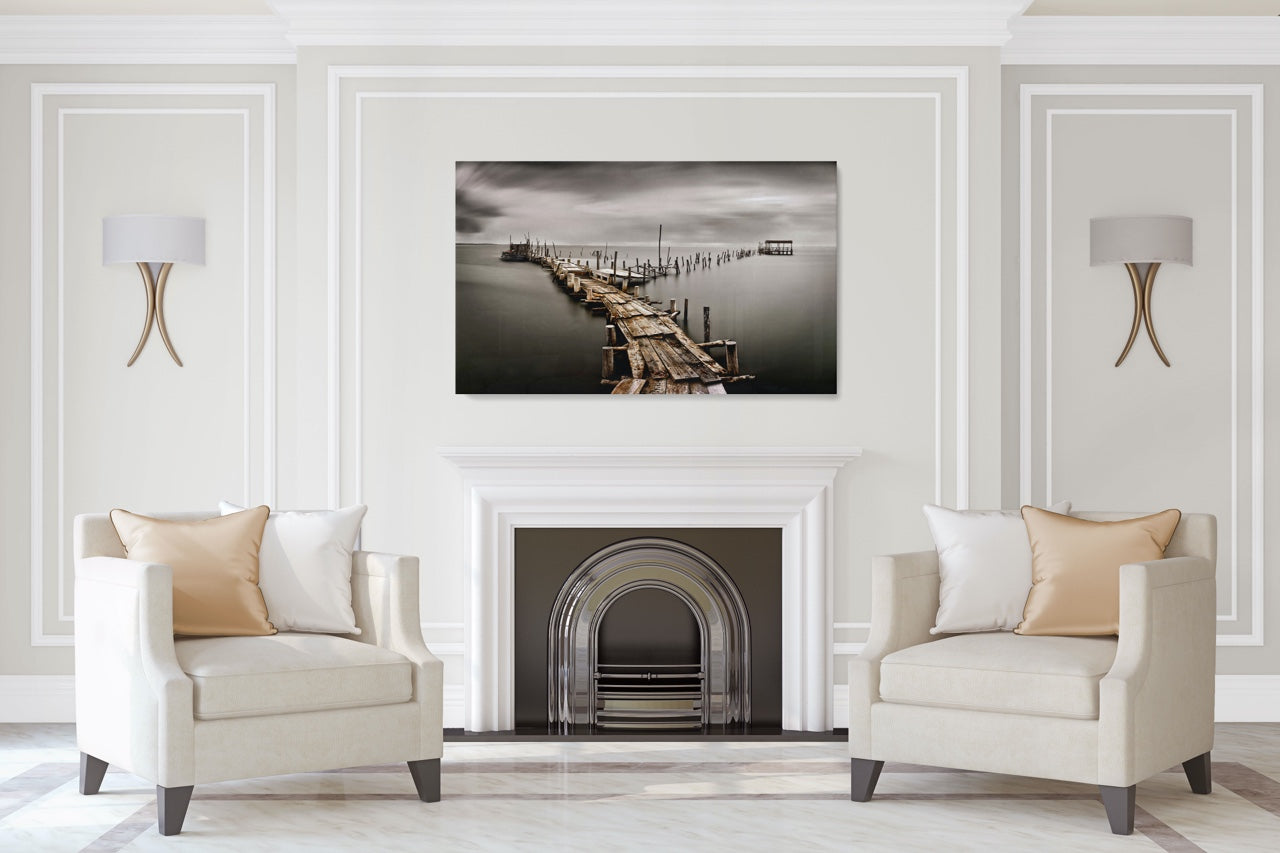 Black and white pier photo art in a modern living room