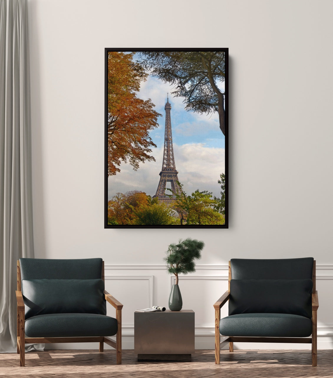 Mid century modern room with framed art of the Eiffel Tower, France