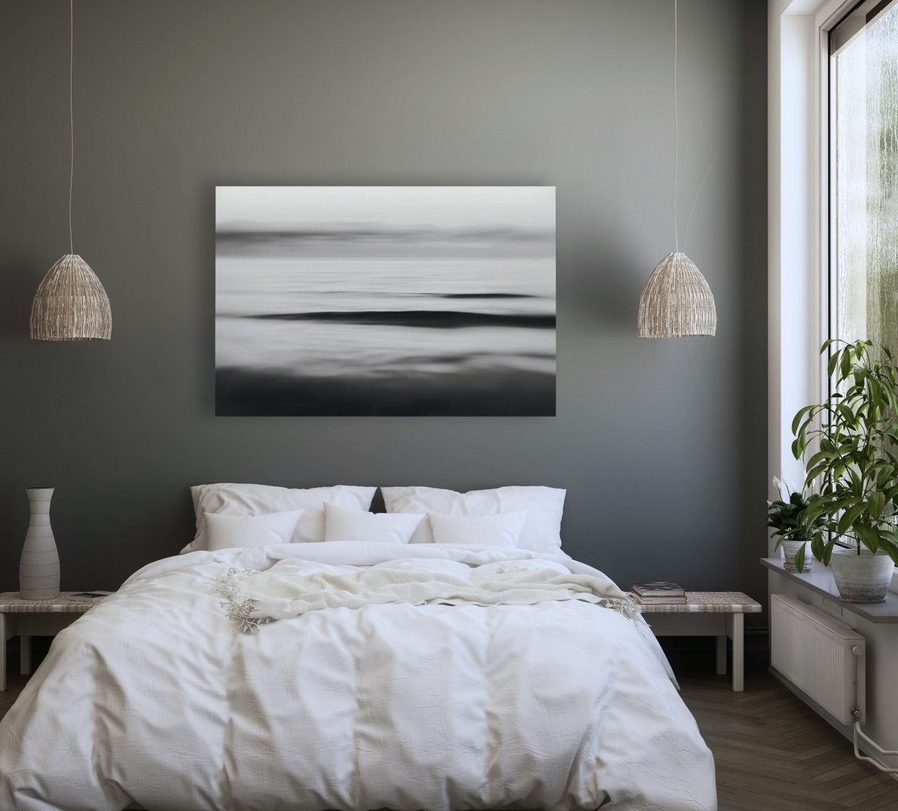 Black and white themed bedroom with abstract art