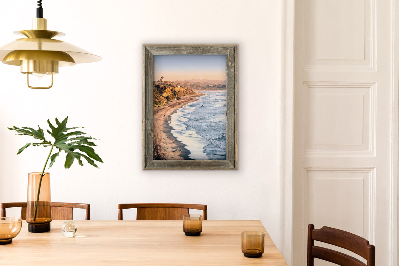 Framed beach photograph in kitchen