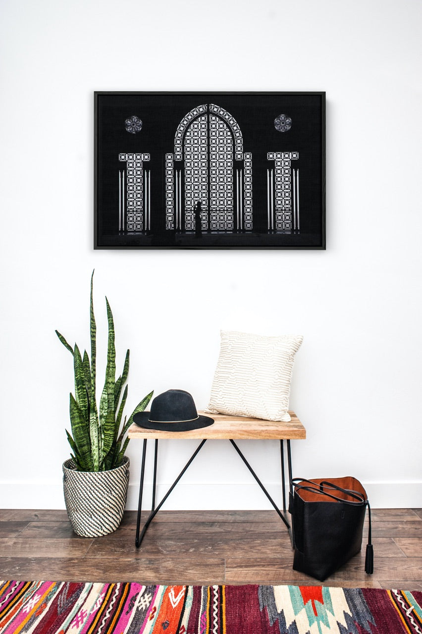 Boho entryway with black and white art