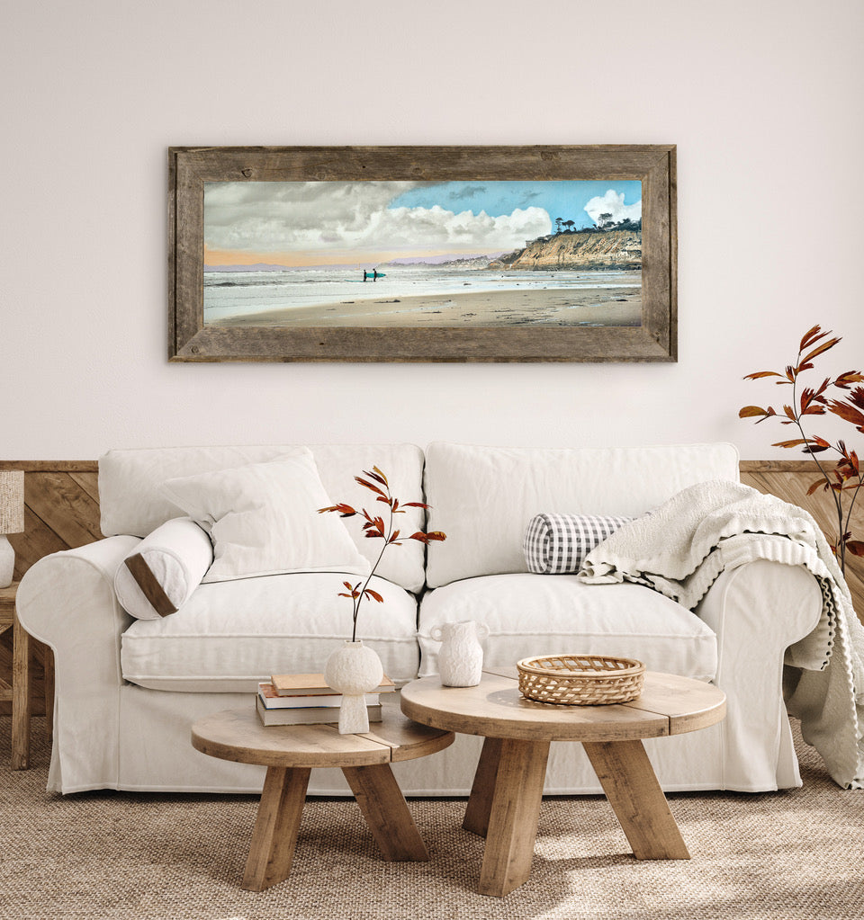 Framed beach art in living room